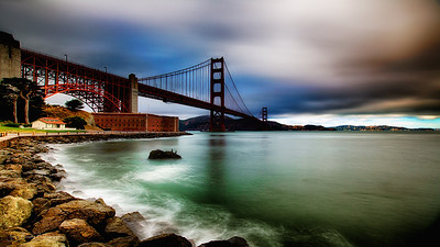 San Francisco Golden Gate Bridge and Sausalito Golden Gate Bridge HDR Portrait  -  One of my favorite shots of the Golden Gate Bridge on a very moody day. High winds, clouds and drizzle all day until finally the sky opened up and I got the drenching I was expecting :)   HDR long exposures & 10 stops of ND filters. - JohnBrody.com / John Brody Photography