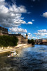 Portrait of a Tugboat on the Seine River near the Notre Dame Cathedral. This is one of a few photos that actually makes me 'feel' like I'm in Paris and not simply looking at a photo - I don't know why...  Shot from Pont Neuf near Pont des Arts.  JohnBrody.com / John Brody Photography