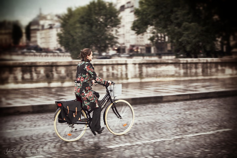 Girl on Bicycle - Pont Neuf Paris - JohnBrody.com / John Brody Photography