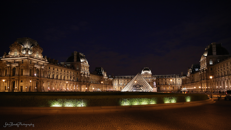 The Louvre Museum with the IM Pei designed Pyramid landmark in Paris. An architectural monument as beautiful as the Mona Lisa and the other artwork inside. You need days to explore it all. The statue room is a must see! - JohnBrody.com / John Brody Photography