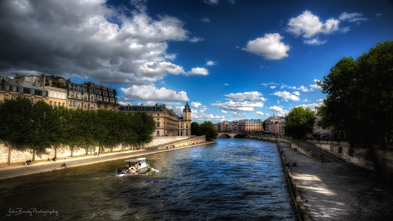 Tugboat on the Seine River near the Notre Dame Cathedral. This is one of a few photos that actually makes me 'feel' like I'm in Paris and not simply looking at a photo - I don't know why...  Shot from Pont Neuf near Pont des Arts.  JohnBrody.com / John Brody Photography