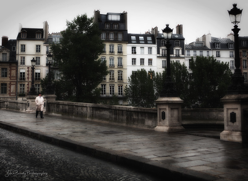 Gentleman Strolling Pont Neuf Paris in the Rain - JohnBrody.com / John Brody Photography