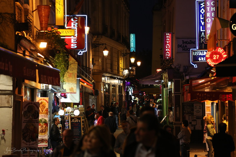 A few hundred feet from the Notre Dame Cathedral is the popular nightspot on Rue de la Huchette near Saint-Michel... a very different feel  - JohnBrody.com / John Brody Photography