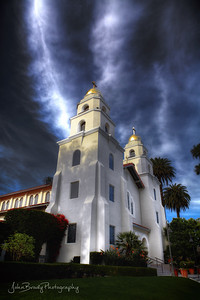 Mystical Lighting and Cloud Cover Over Church - This scene seems like a composite, but it's not... The church was completely covered with clouds except for the small fingers of cloud breaks and light that pointed downward. I found it quite fascinating --- John Brody Photography - JohnBrody.com