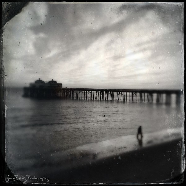 A bit of Lomo/Holga Photography - A beachcomber with the Malibu pier as a backdrop - JohnBrody.com / John Brody Photography