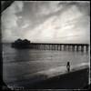 A bit of Lomo/Holga Photography - A beachcomber with the Malibu pier as a backdrop - JohnBrody.com / John Brody Photography