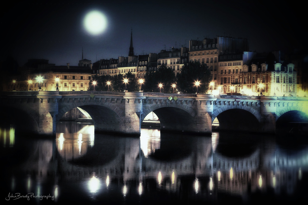 Moonrise Over Pont Neuf Paris France.  When visiting The City of Lights, my days usually begin and end here, my favorite place in Paris. It's a swirl of activity surrounded by dozens of cultural greats including the Louvre, Eiffel Tower, Notre Dame Cathedral, the Seine Riverfront walkways and the D'Orsay Museum with its van Gogh paintings to name a few. The list is endless. A wonderful place and a favorite of Thomas Jefferson, van Gogh, Monet and many other notables. You must visit... John Brody Photography / JohnBrodyPhotography.com / JohnBrody.com