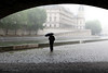 "A Little Rain Gives Solitude To A Stroller - Pont Neuf Bridge over the River Seine in Paris, an area usually swarming with people - AKA  ""The Umbrella Man"" - JohnBrody.com / John Brody Photography"