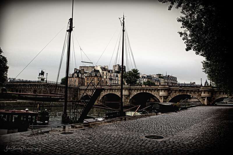 Riverside Walkway at Pont Neuf Bridge Paris - After the Rain - JohnBrody.com