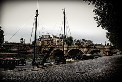 Riverside Walkway at Pont Neuf Bridge Paris - After the Rain - JohnBrody.com
