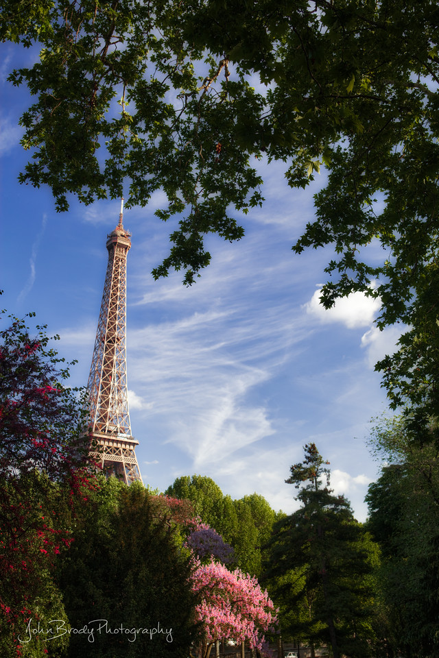 Something Bright and simple for a change! Is there anyone who's been to Paris and hasn't taken this shot? I doubt it, but here's another - My simple snapshot of the Eiffel Tower and surrounding grounds...