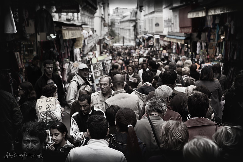 On weekends ALL streets near Sacre Coeur look like this... Adjust your schedule accordingly - JohnBrody.com / John Brody Photography