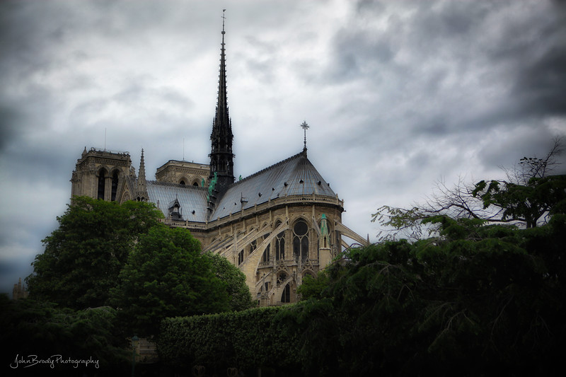 Another Moody Image of Notre Dame Cathedral - I think I'm watching too many Tim Burton movies! 😮 It's dark as hell, but that was the day. I just like the feel and angle of the image ... John Brody Photography