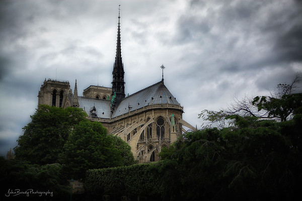 Another Moody Image of Notre Dame Cathedral - I think I'm watching too many Tim Burton movies! 😮 It's dark as hell, but that was the day. I just like the feel and angle of the image --- John Brody Photography - JohnBrody.com