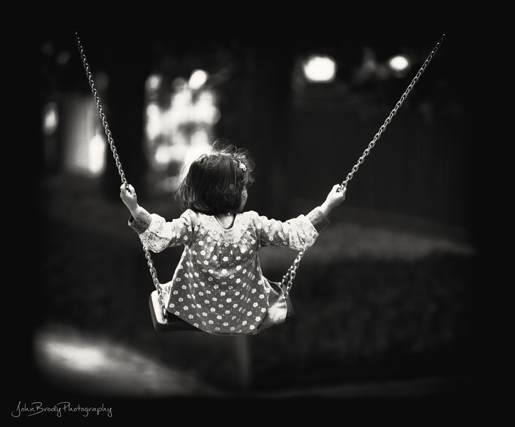 Young Girl Plays on Swing in Tuileries Garden Paris. Near the Louvre and the Notre Dame Cathedral, This garden was a training ground for great artists like Vincent van Gogh and Monet, A must visit for both tourists and locals  - JohnBrody.com / John Brody Photography