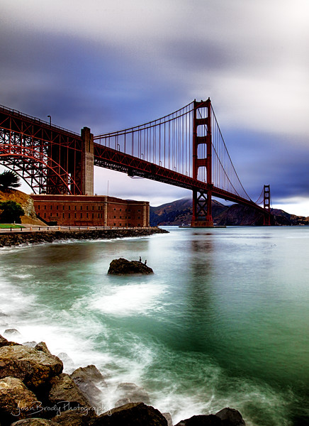 San Francisco Golden Gate Bridge and Sausalito - HDR Portrait  -  One of my favorite shots of the Golden Gate Bridge on a very moody day. High winds, clouds and drizzle all day until finally the sky opened up and I got the drenching I was expecting :)   HDR long exposures & 10 stops of ND filters. - JohnBrody.com / John Brody Photography