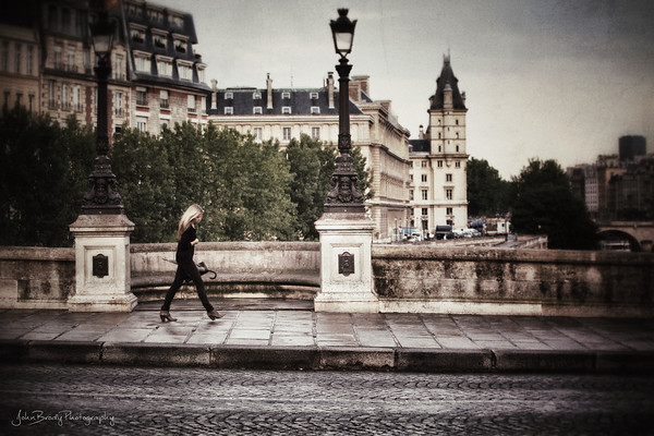A Fashionable Stroller in the Rain on Pont Neuf, Paris  - JohnBrody.com / John Brody Photography