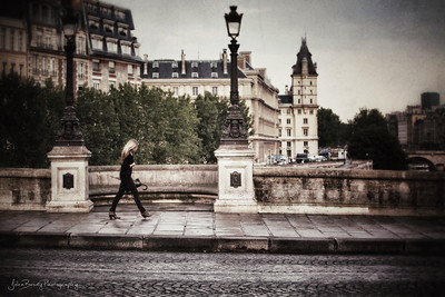 A Fashionable Stroller in the Rain on Pont Neuf, Paris   - John Brody Photography / JohnBrodyPhotography.com / JohnBrody.com