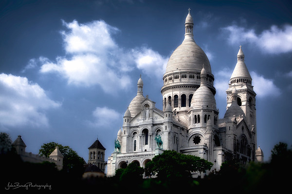 Sacre Coeur Basilica and hillside artist colony shot from a nearby rooftop in Montmartre . The Montmartre hillside artist colony was a starting ground for a long list of painters: including Vincent van Gogh,  Salvador Dalí, Claude Monet, Henri de Toulouse-Lautrec, Piet Mondrian, Pablo Picasso, Camille Pissarro. and Amedeo Modigliani to name  small sample...,   This history and the stunning architecture make this on of the most visited attractions in Paris - JohnBrody.com / John Brody Photography