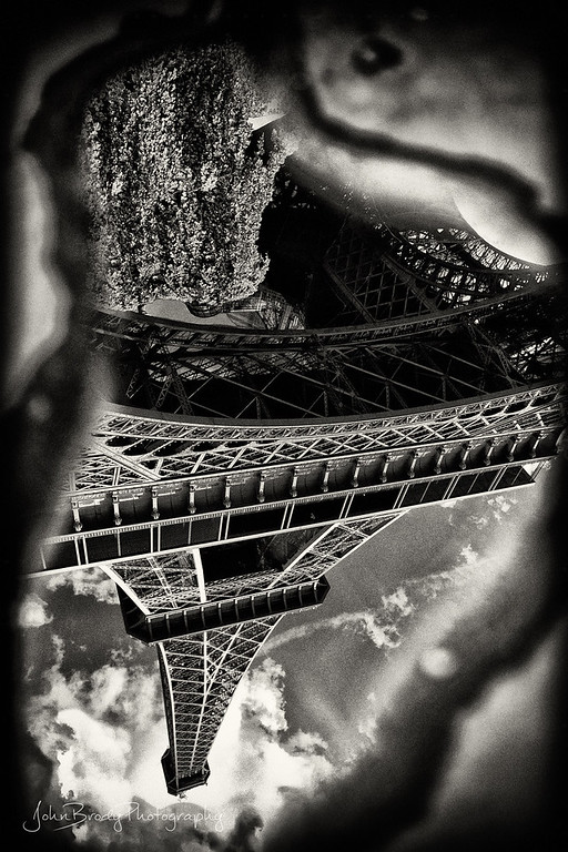 A Puddle In Paris Holds The Eiffel Tower - JohnBrody.com / John Brody Photography