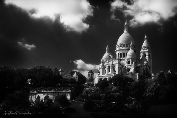Sacre Coeur Basilica, Paris - One of the most popular (and photographed) destinations in Paris. I also like to visit because it's on the hill in Montmartre, an artist colony where many struggling artists had studios. These included Salvador Dalí, Vincent van Gogh, Claude Monet, and Pablo Picasso. - JohnBrody.com / John Brody Photography