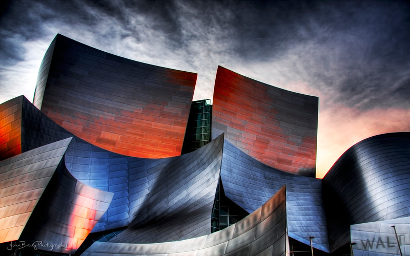 Walt Disney Concert Hall in Los Angeles - High-Res HDR Image. I've been asked by a few people if this was shot in HDR on iPhone.  As noted, it IS a high-resolution HDR Photo, but it was created from seven Canon CR2 RAW files shot in increments from -2 to +2 and then merged and toned in HDR software. If an iPhone ever comes out the could take a shot, I will buy it instantly. I should also mention that part of the images' color and feel are due to the fact that there were brush fires in the surrounding hillsides that day, and it was also shot at sunset. There were a lot of factors that came into play...  JohnBrody.com / John Brody Photography