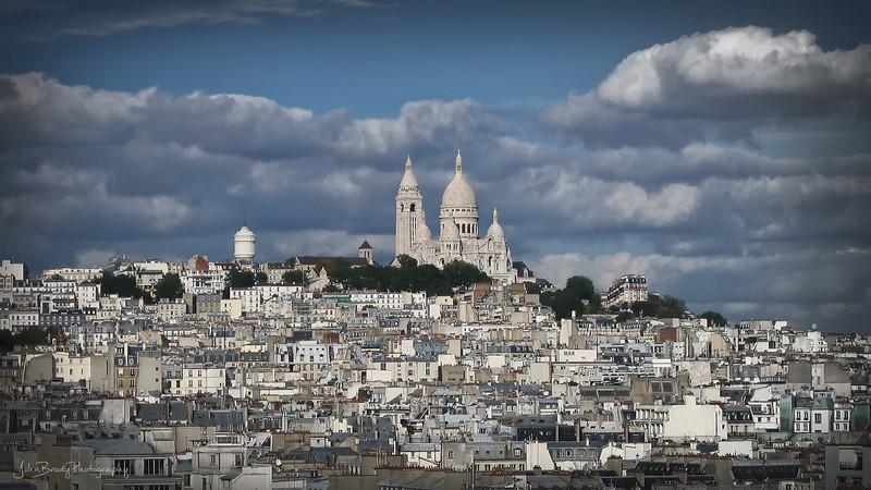 Sacre Coeur basilica, Paris. Taken from the Arch de Triumph across the city - JohnBrody.com