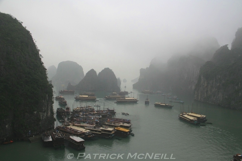Halong Bay, northeastern Vietnam. Thousands of limestone karsts poking up out of the sea and some beautiful beaches too. This area has two UNESCO designations, one for beauty, and even though it was misty you can see that it was a neat place to cruise around in.