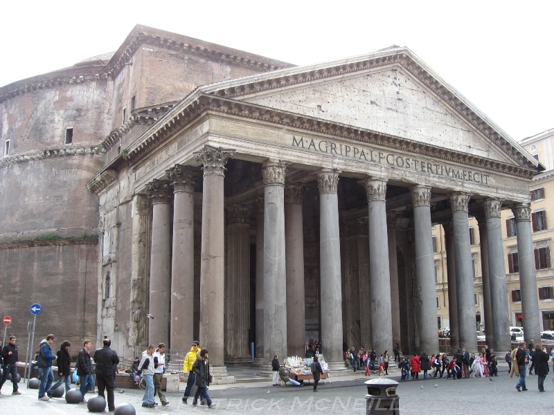 The Pantheon, an architectural game changer. You can see the round main building behind the triangle topped entrance. There is a giant hole in the centre of the dome. The painter Raphael's grave is in here.