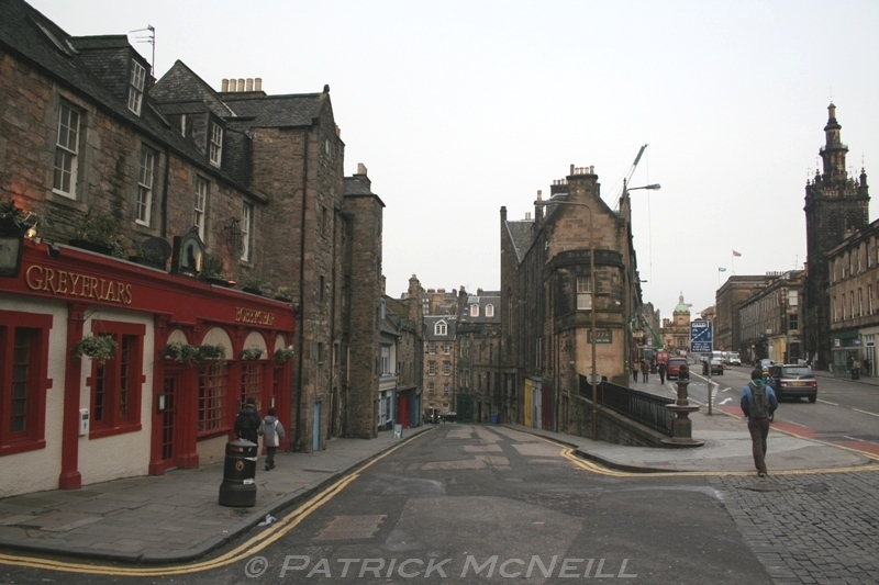 "The ""old town"" of Edinburgh, lots of twisting streets, narrow alleyways, pubs, and very old buildings."