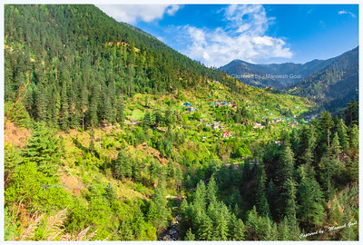Sights around Banjar region. Green forests and fields peppered with traditional Himachali structures.