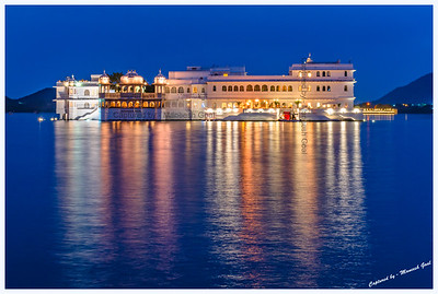 Lake Palace, located on an island in Lake Pichola, during the blue-hour. Picture taken from Ambrai Ghat, Udaipur.