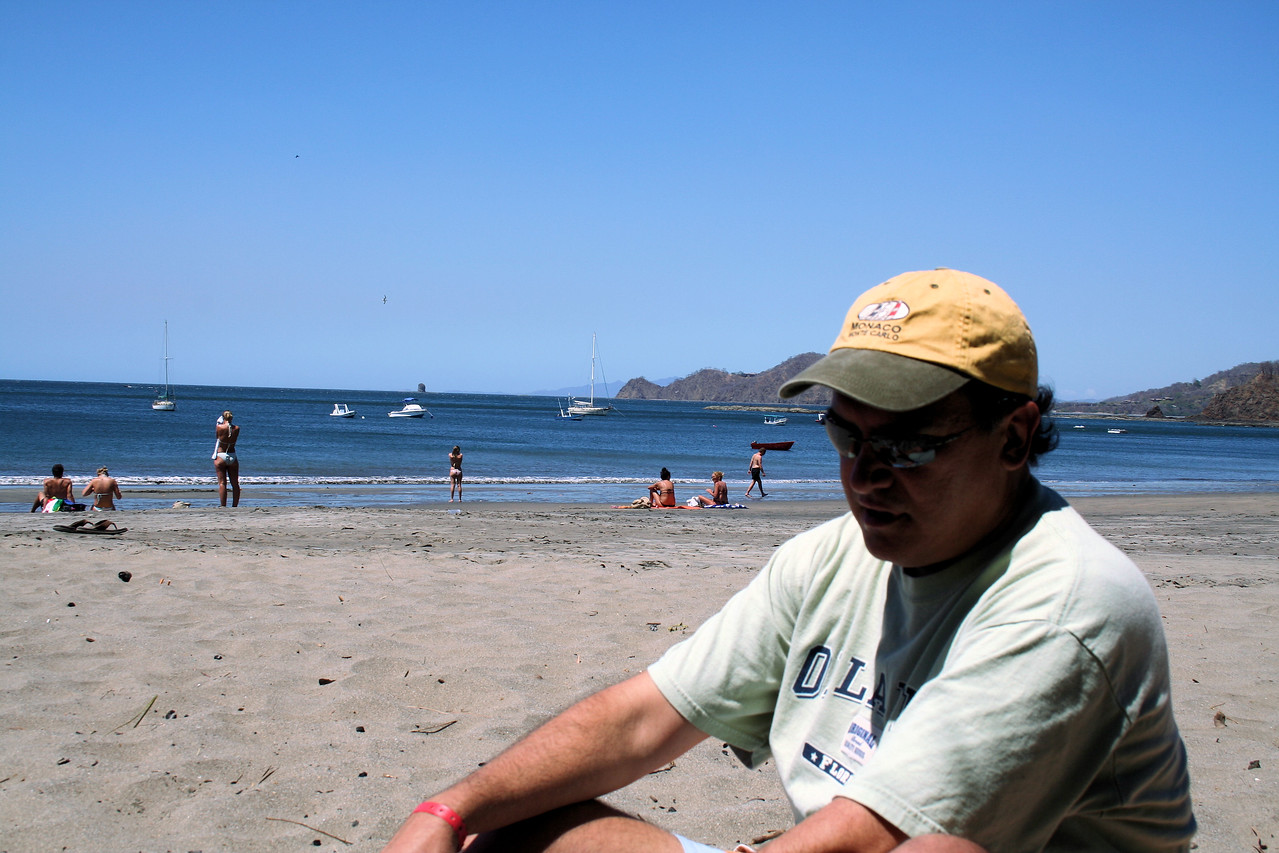 Cesar reflects on his thoughts as he sits on the sand.  <br /> <br /> Cesar reflexiona mientras esta sentado en la arena.