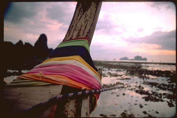 Ao Ton Sai boat stern cloth wraps sunset, Thailand
