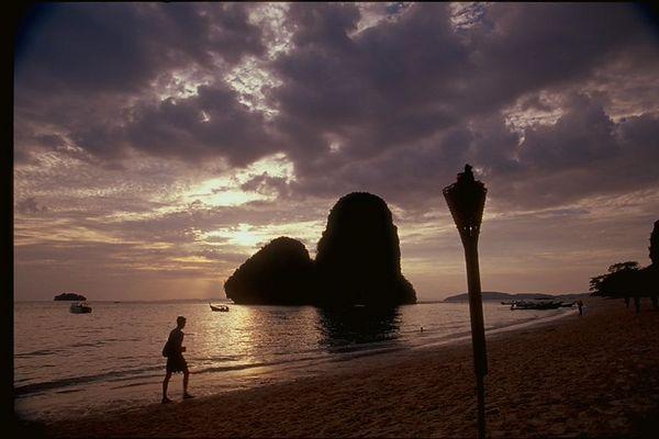 West Railey beach at sunset, one man walking, Thailand
