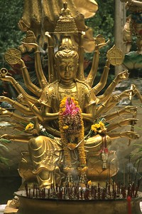 Seated Golden Buddha statue with many arms near Krabi, Thailand