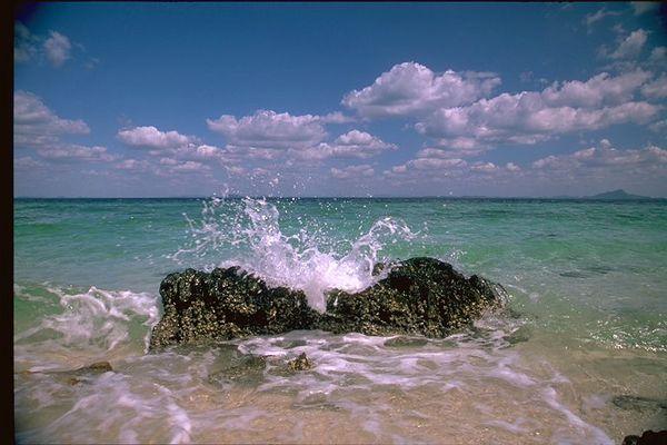 Andaman sea island, ocean splashes rocks, Thailand