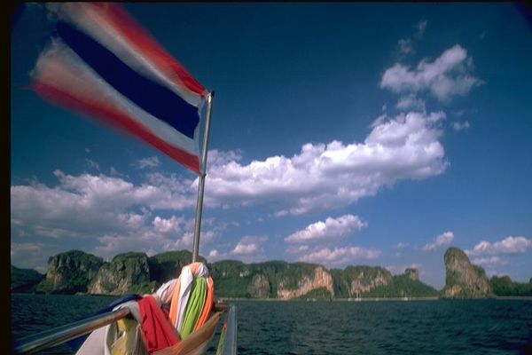 Andaman Sea boat ride with Thai flag, near Krabi, Thailand