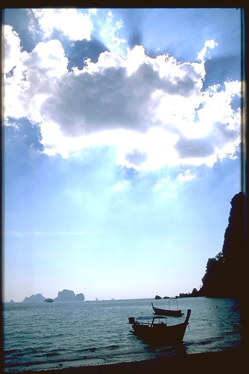 Ao Ton Sai beach sun cloud over ocean, Thailand