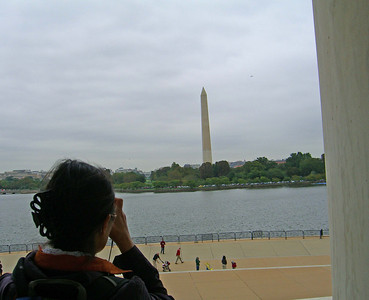 Fei Fei from the steps of the Jefferson Memorial overlooking the Tidal Basin, the Washington Monument and the White House in the distance