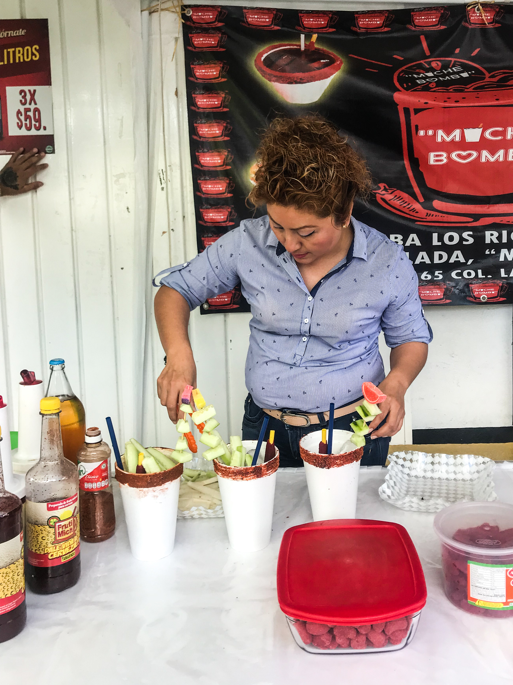 Gomichela or crazy michelada stand outside a convenience store in Felipe Carrillo Puerto