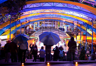 Free music venues are throughout the city during the games. Even the rain does not faze an incredible crowd at this Robson Square concert. An unprecedented number of spectators, enthusiasts, revelers, and visitors descends on downtown daily to embrace the Olympic spirit, the likes of which Vancouver has never seen. Vancouver, BC.