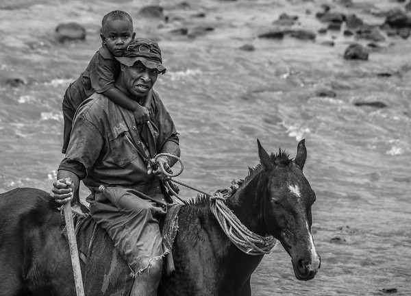 Father and son on horseback