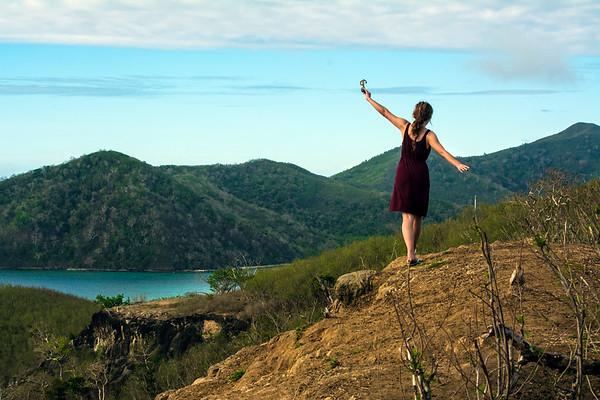 Girl walking along edge of cliff