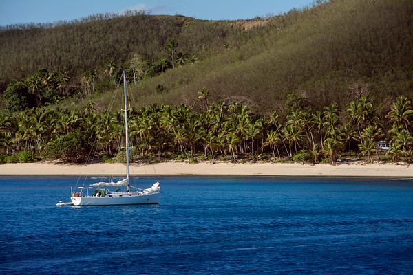 Sailboat moored in tropical water