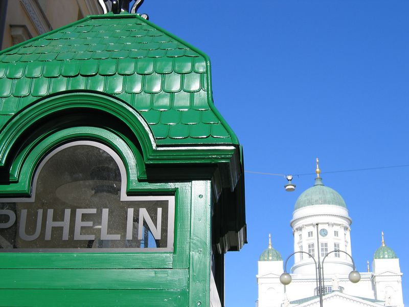 Traditional phone booth on Sofiankatu with the Helsinki Lutheran Church in background
