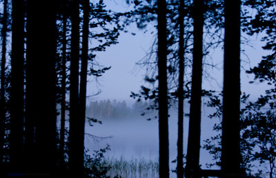 Mist over the lake at night.  Hossänjarvi, Oulu. Finland.