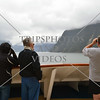 Cruise passengers enjoying the scenic view along Milford Sound in Fiordland National Park, New Zealand.