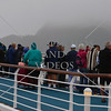 Cruise passengers enjoying the scenic view along the Breaksea Sound in Fiordland National Park, New Zealand.