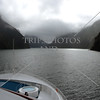 Ship cruising along Milford Sound in Fiordland National Park, New Zealand.
